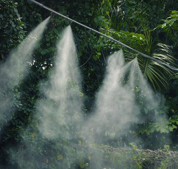 pipe mist spray system emitting water vapour into the air