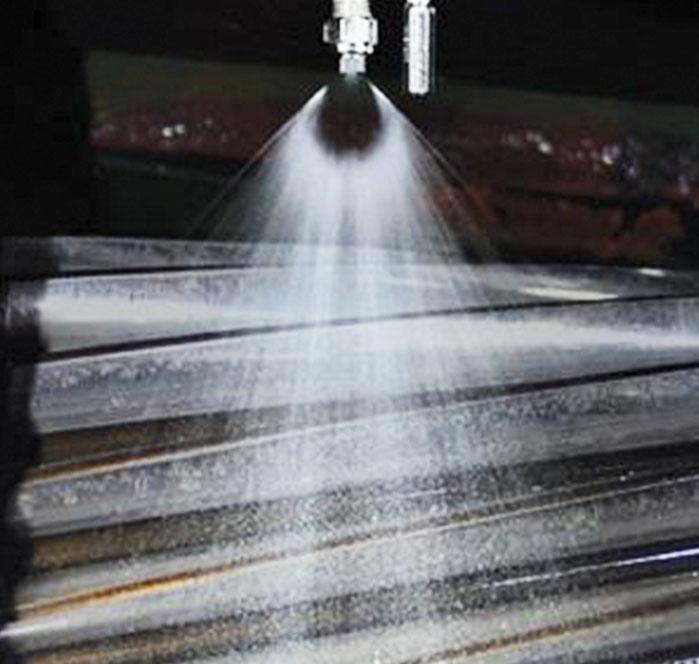 spray lubricating roller system